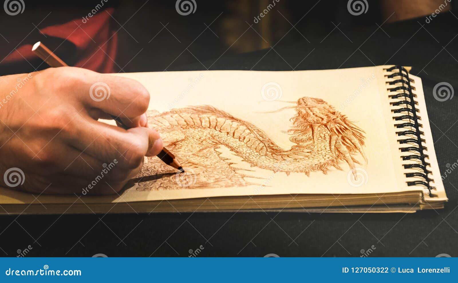 Libro del rasguño del sketchbook de los dragones del dibujo de la mano de Illustrator