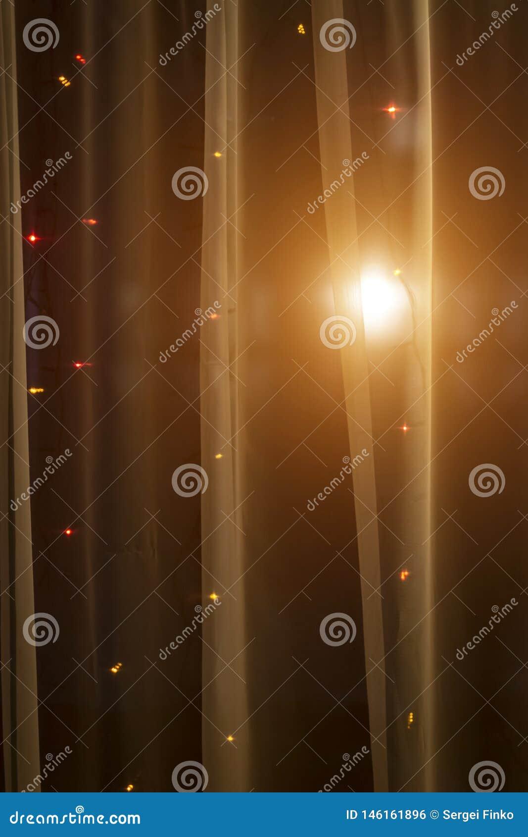 Licht door het gordijn