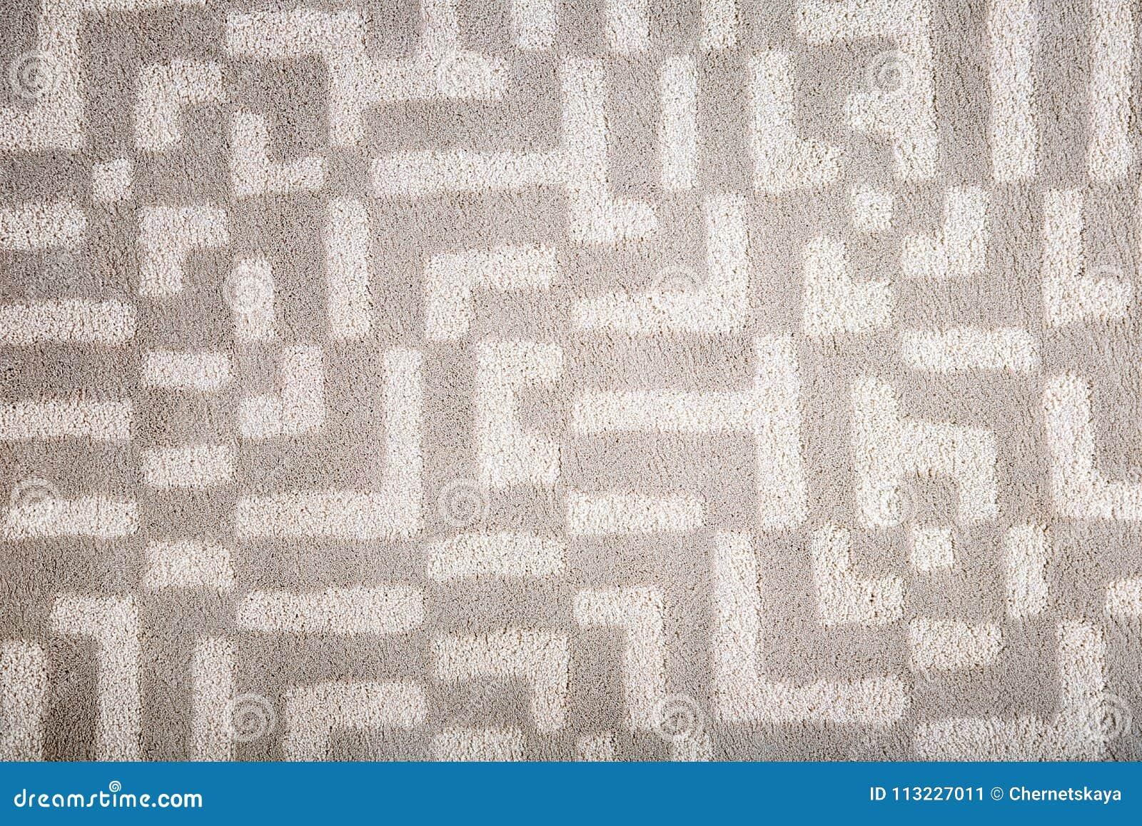 Licht tapijt met patroon