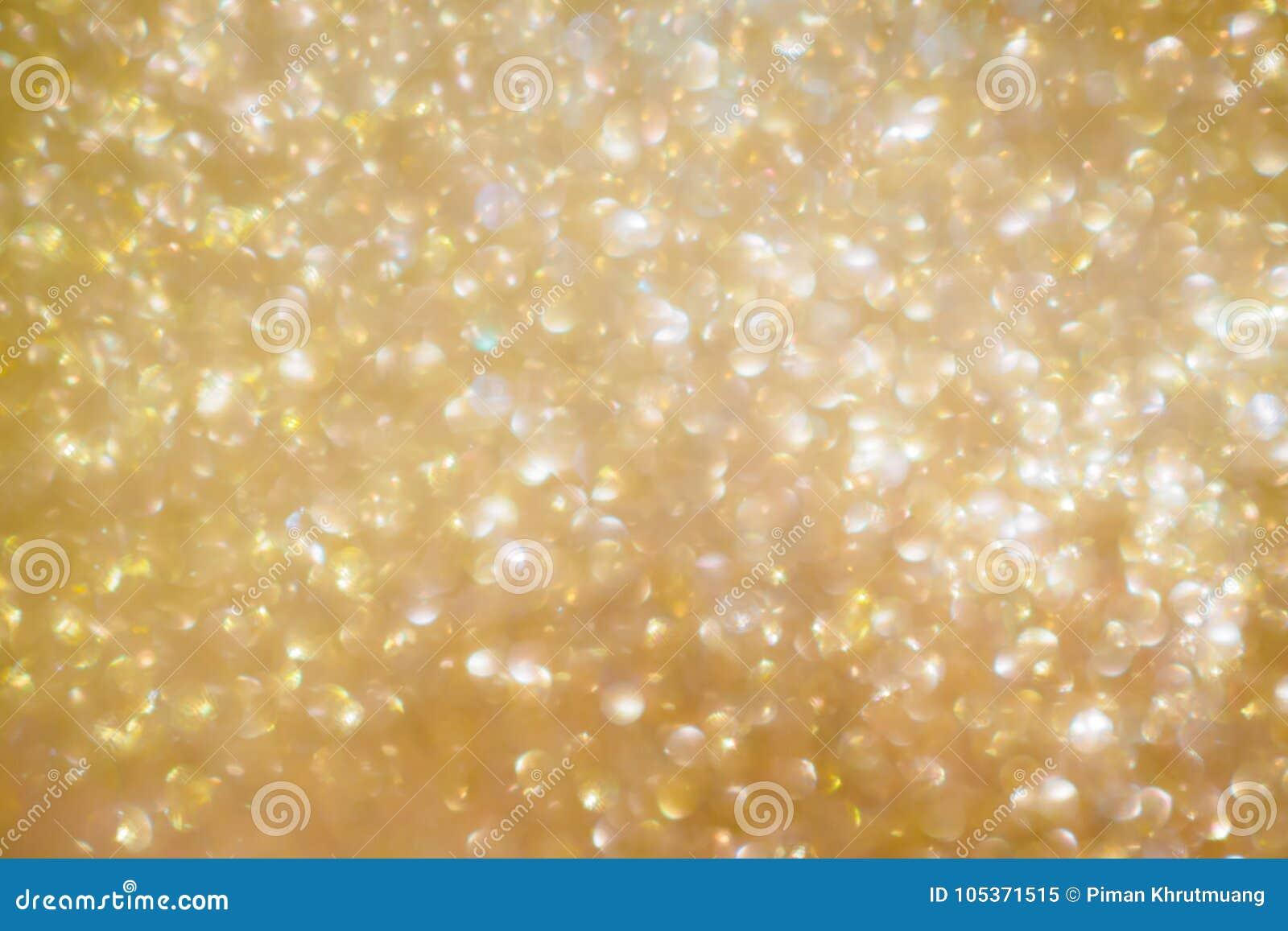 Lichte het onduidelijke beeldachtergrond van de Kerstmis gouden gloed bokeh
