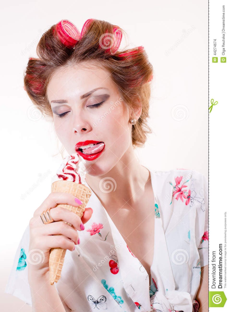 Licking dessert: beautiful young woman eating ice cream cone eyes closed isolated over white copy space background