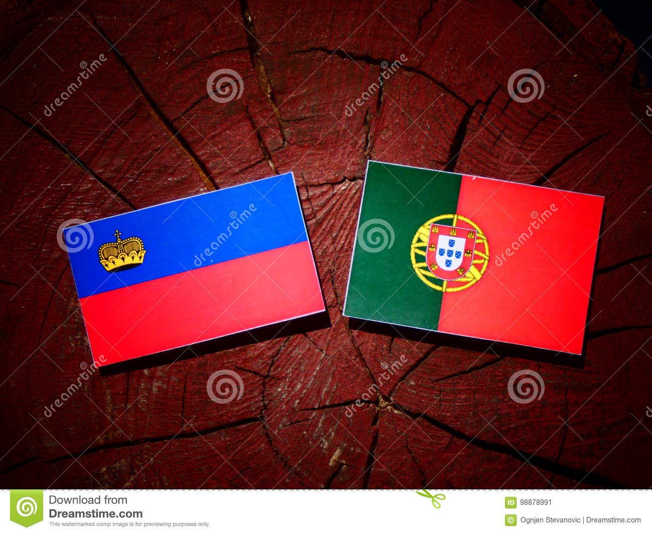 Liechtenstein flag with Portuguese flag on a tree stump isolated