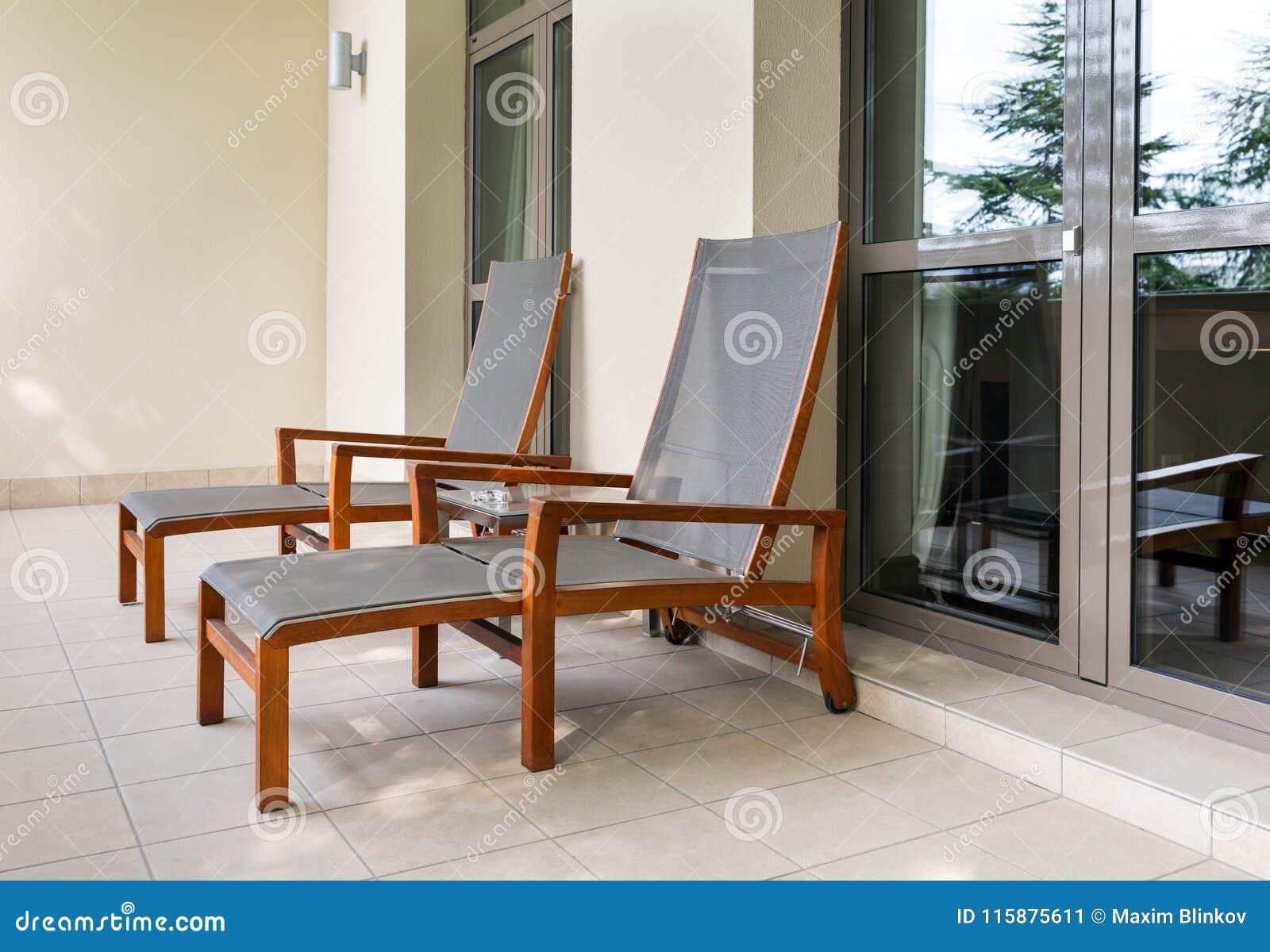 liege zwei auf balkon stockbild bild von loggia freizeit 115875611. Black Bedroom Furniture Sets. Home Design Ideas