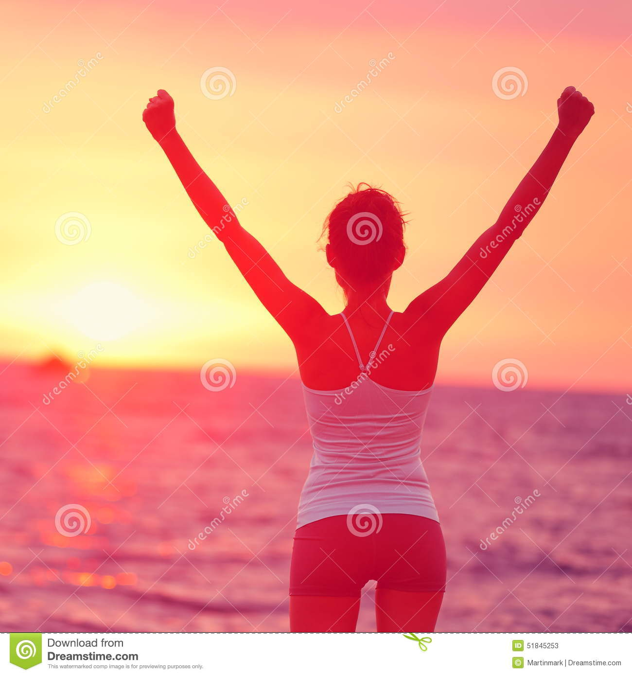 Life achievement - happy woman arms up in success
