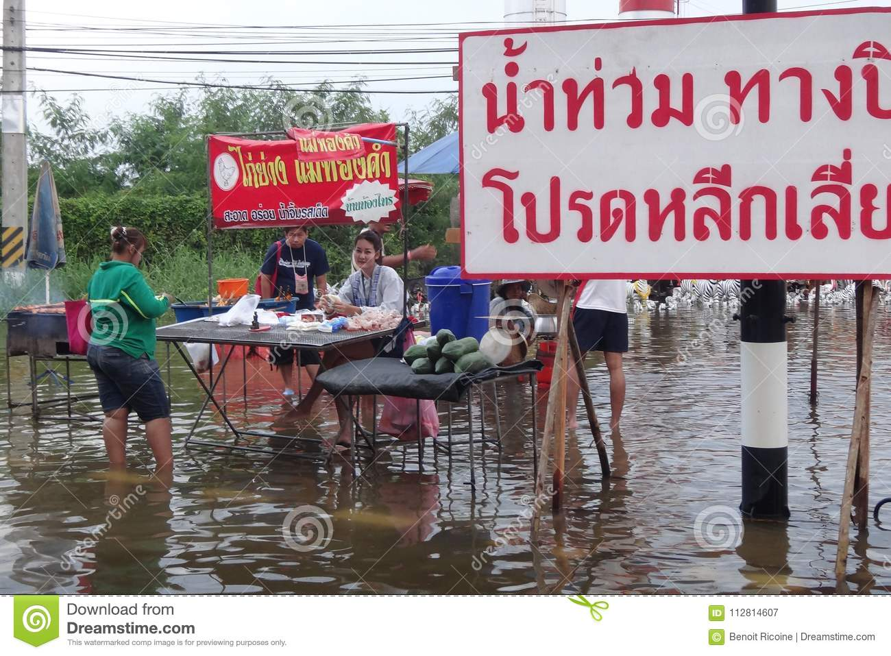 life and business are as usual in flooded pathum thani thailand in