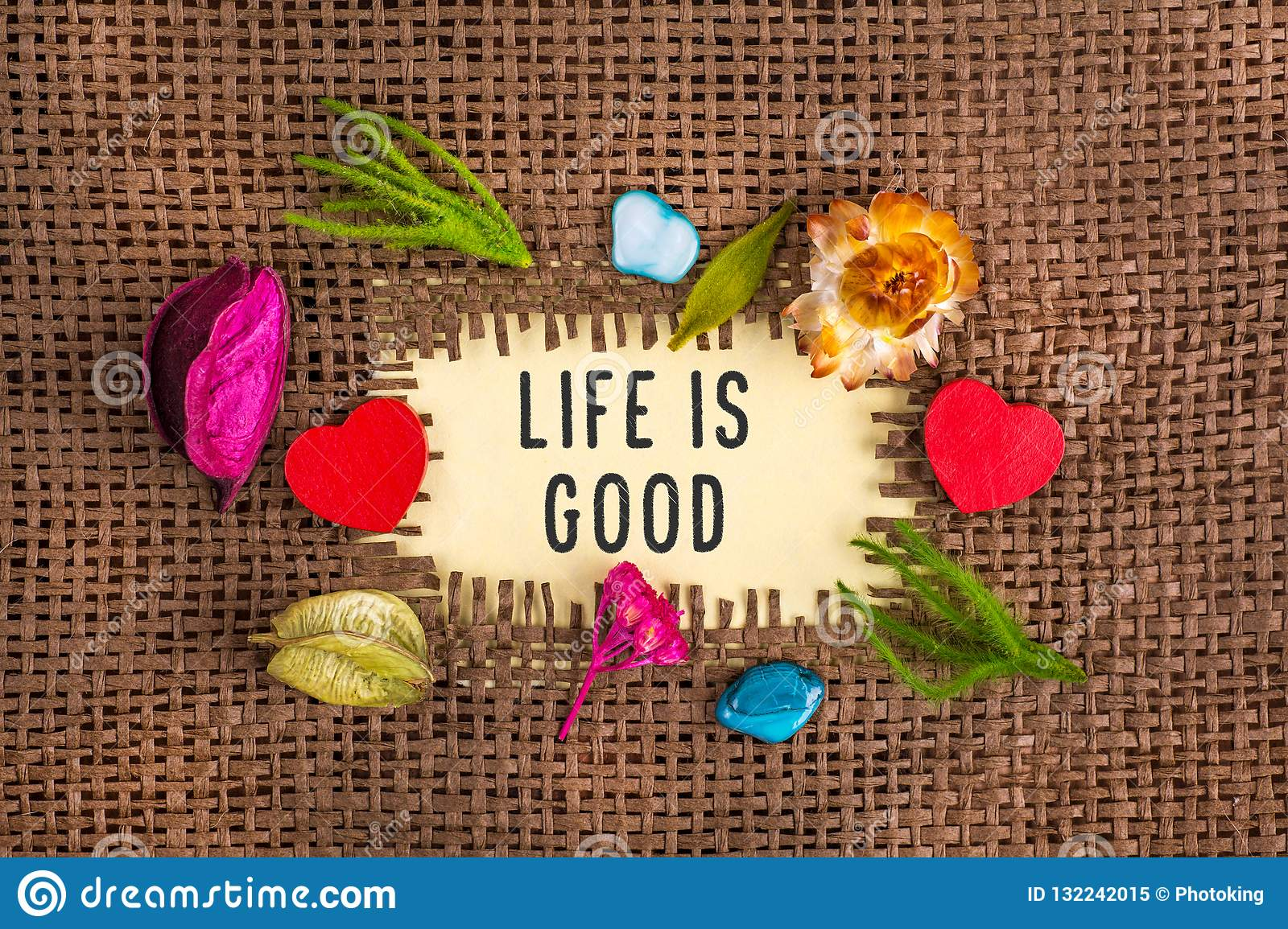 Life is good written in hole on the burlap