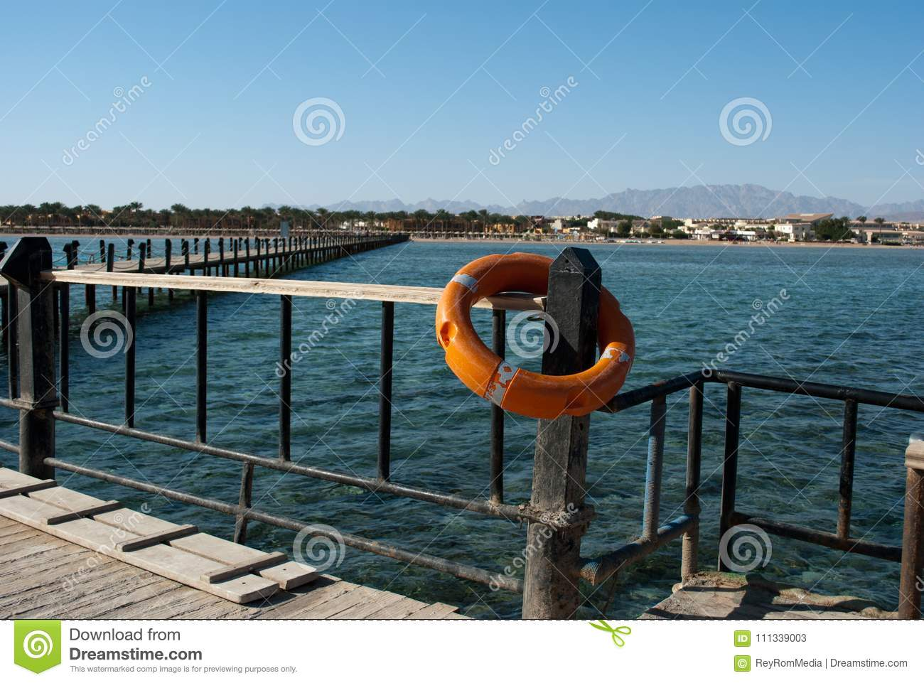 Lifebuoy And Pier. Orange Lifebuoy On Barrier Pillar. Save ...