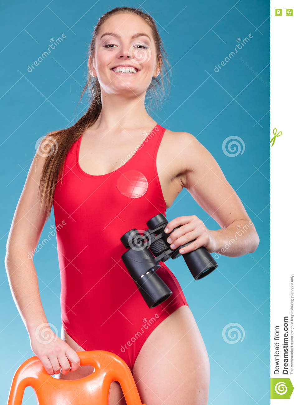e5c6d719842e Lifeguard On Duty With Rescue Buoy Supervising. Stock Photo - Image ...
