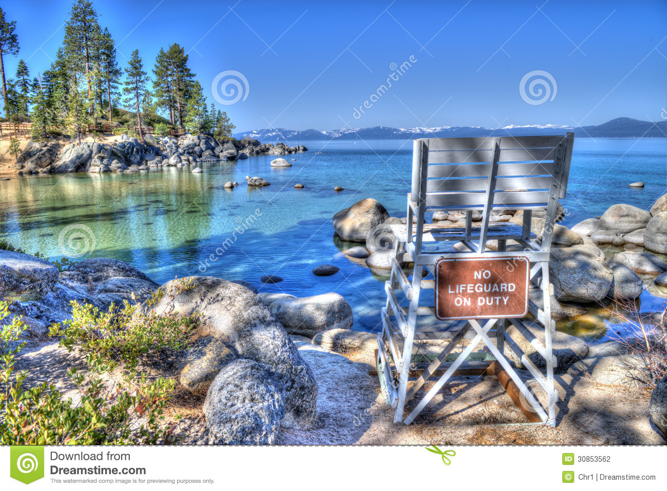 Wooden lifeguard chair in a beautiful beach on the shores of lake