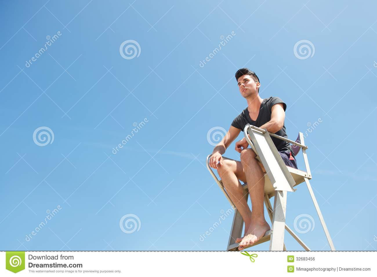 Lifeguard Sitting On Elevated Chair Stock Photo Image