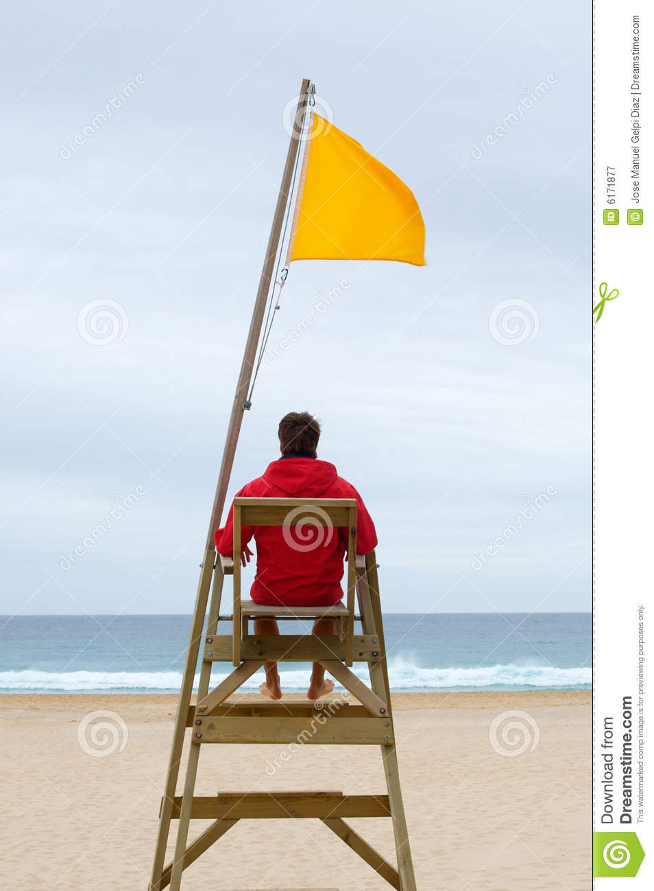 Lifeguard Sitting In His Chair Royalty Free Stock