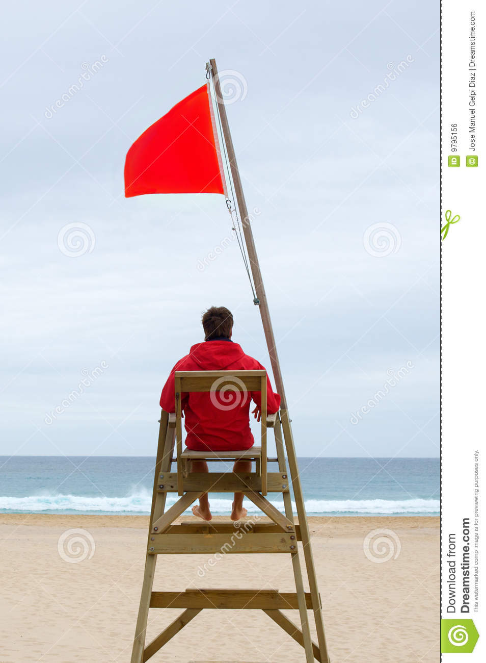 Lifeguard Sitting In His Chair Royalty Free Stock Image