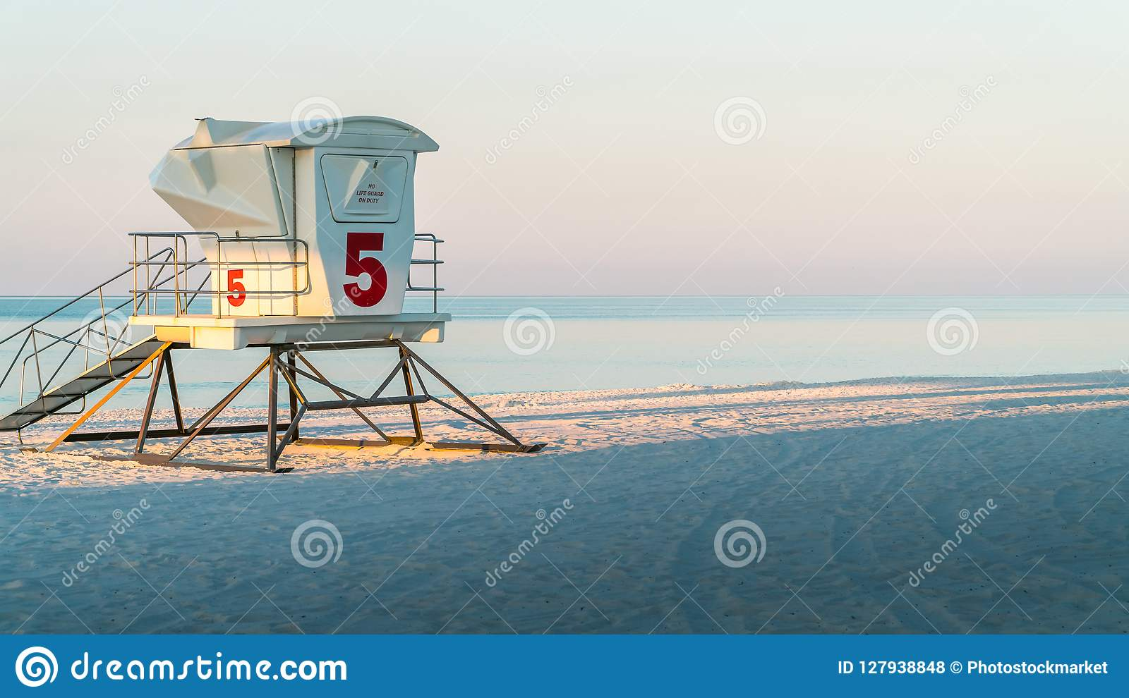 Lifeguard station on a beautiful white sand Florida beach with blue water.