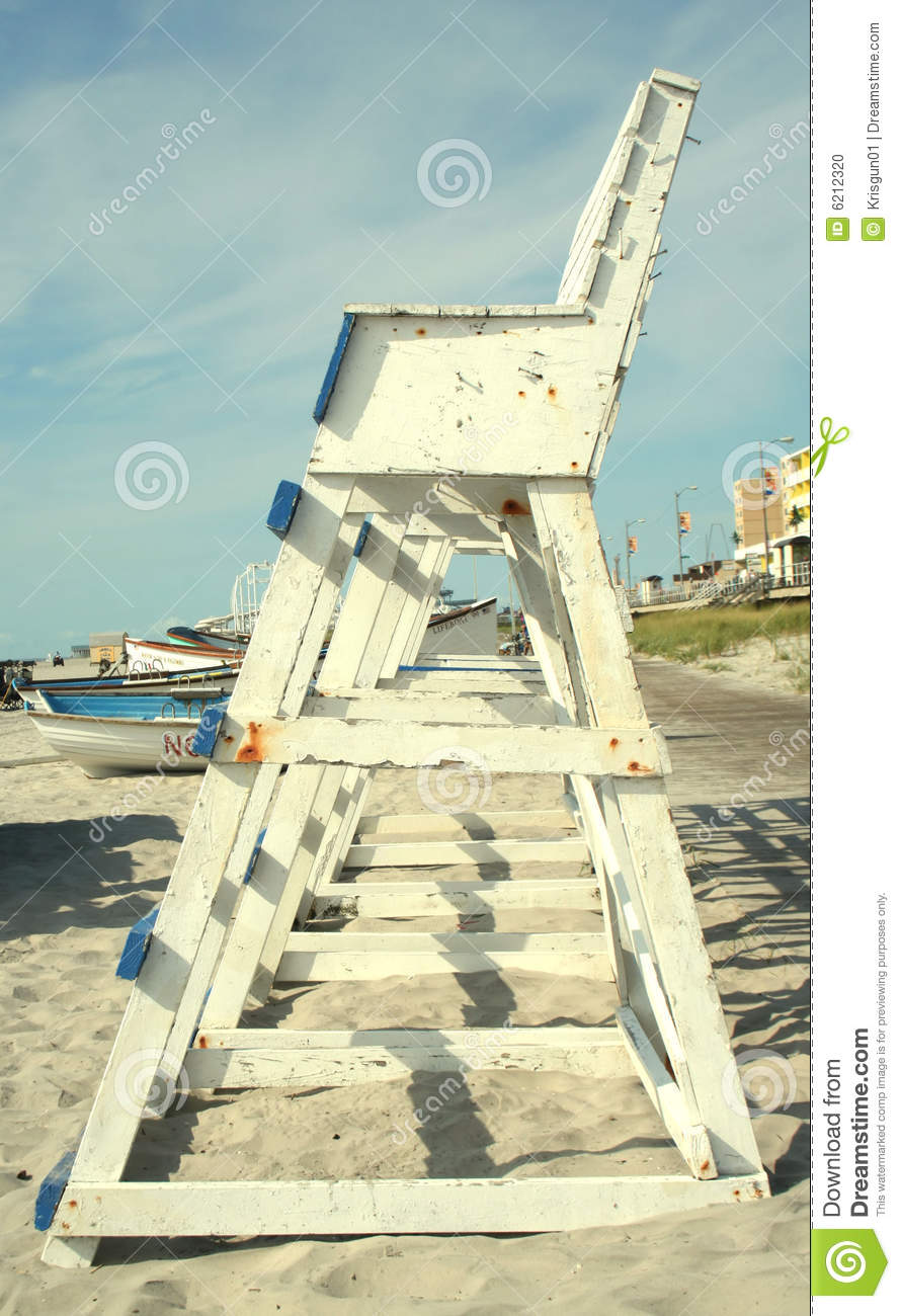 shot of the side of a row of blue and white painted wooden lifeguard ...