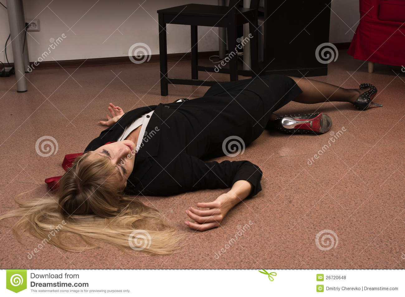 lifeless business woman lying on the floor royalty free