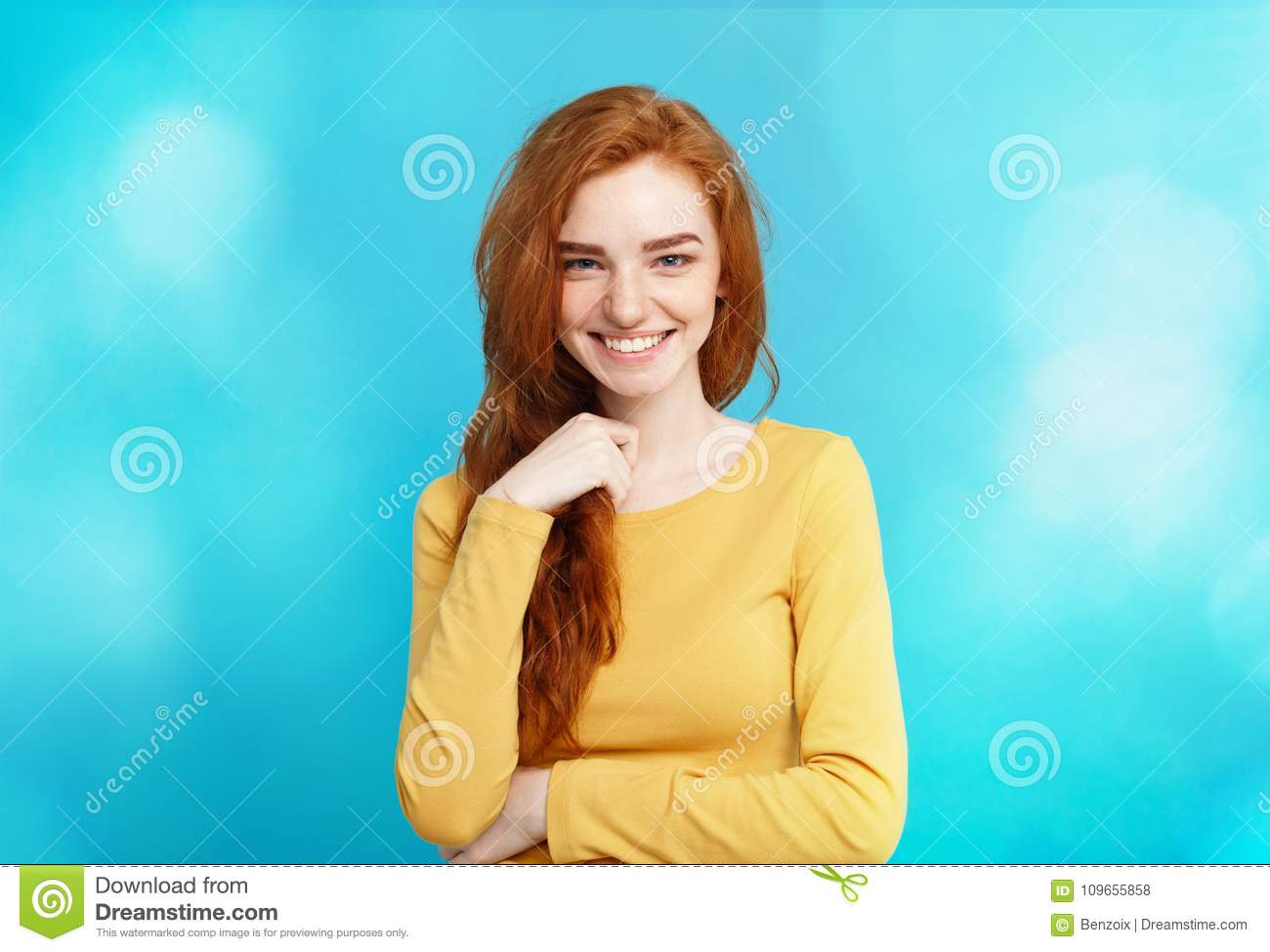Lifestyle concept - Close up Portrait young beautiful attractive ginger red hair girl playing with her hair with shyness
