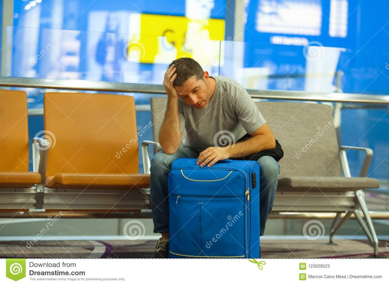 Stressed Out Students How Boarding >> Young Tired Tourist Man In Airport With Suitcase Sitting Worried And