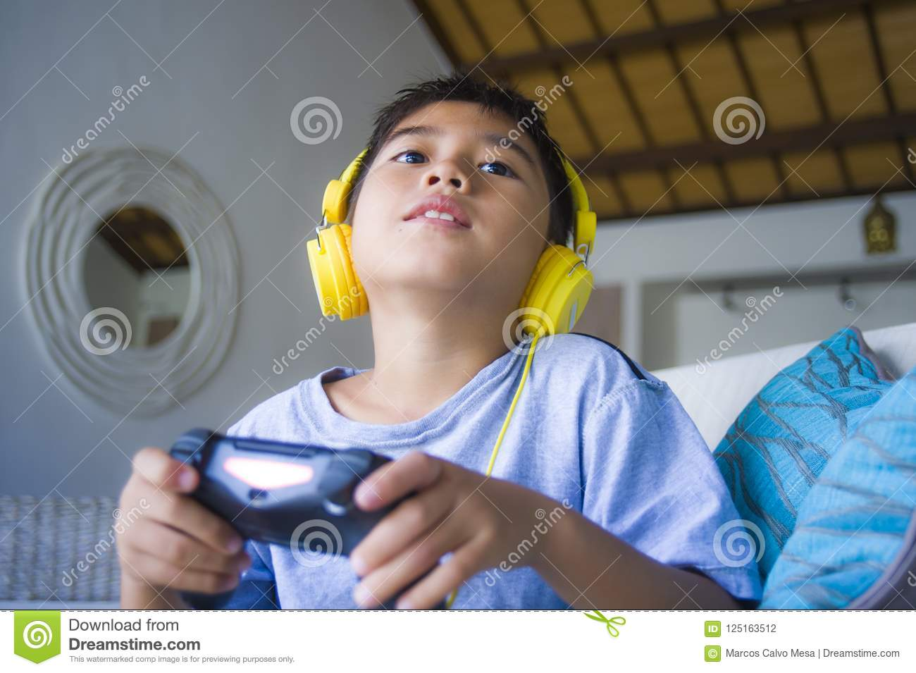 Latin Young Boy Excited And Happy Playing Video Game Online