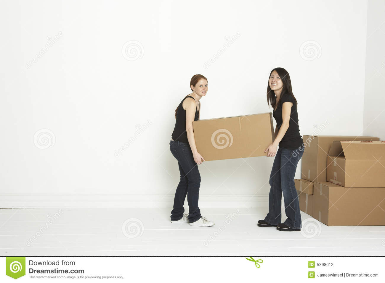 lifting box into first apartment stock photo
