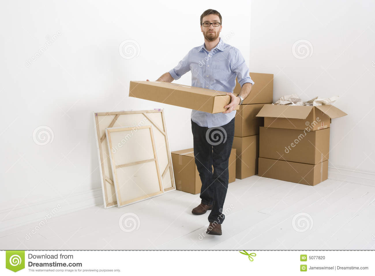Lifting Boxes For Lift Assists : Lifting a small box stock photo image of home white