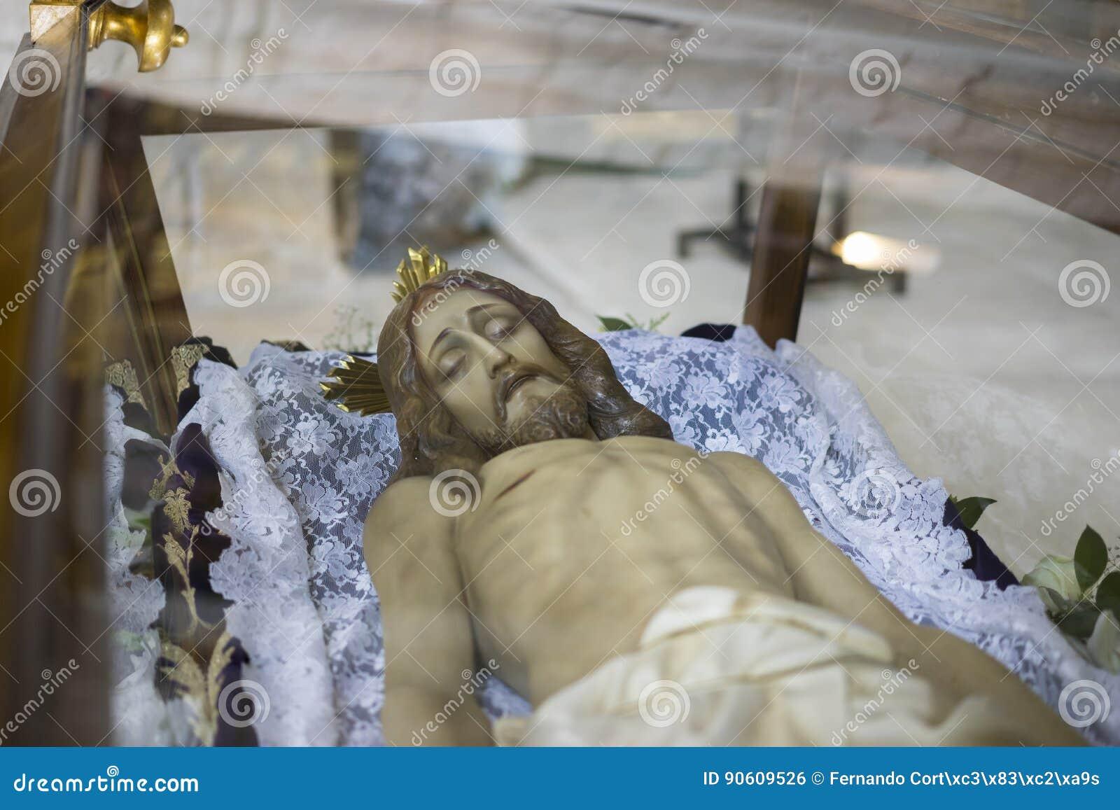 Liggande jesus christ helig vecka i Spanien, bilder av oskulder och beträffande