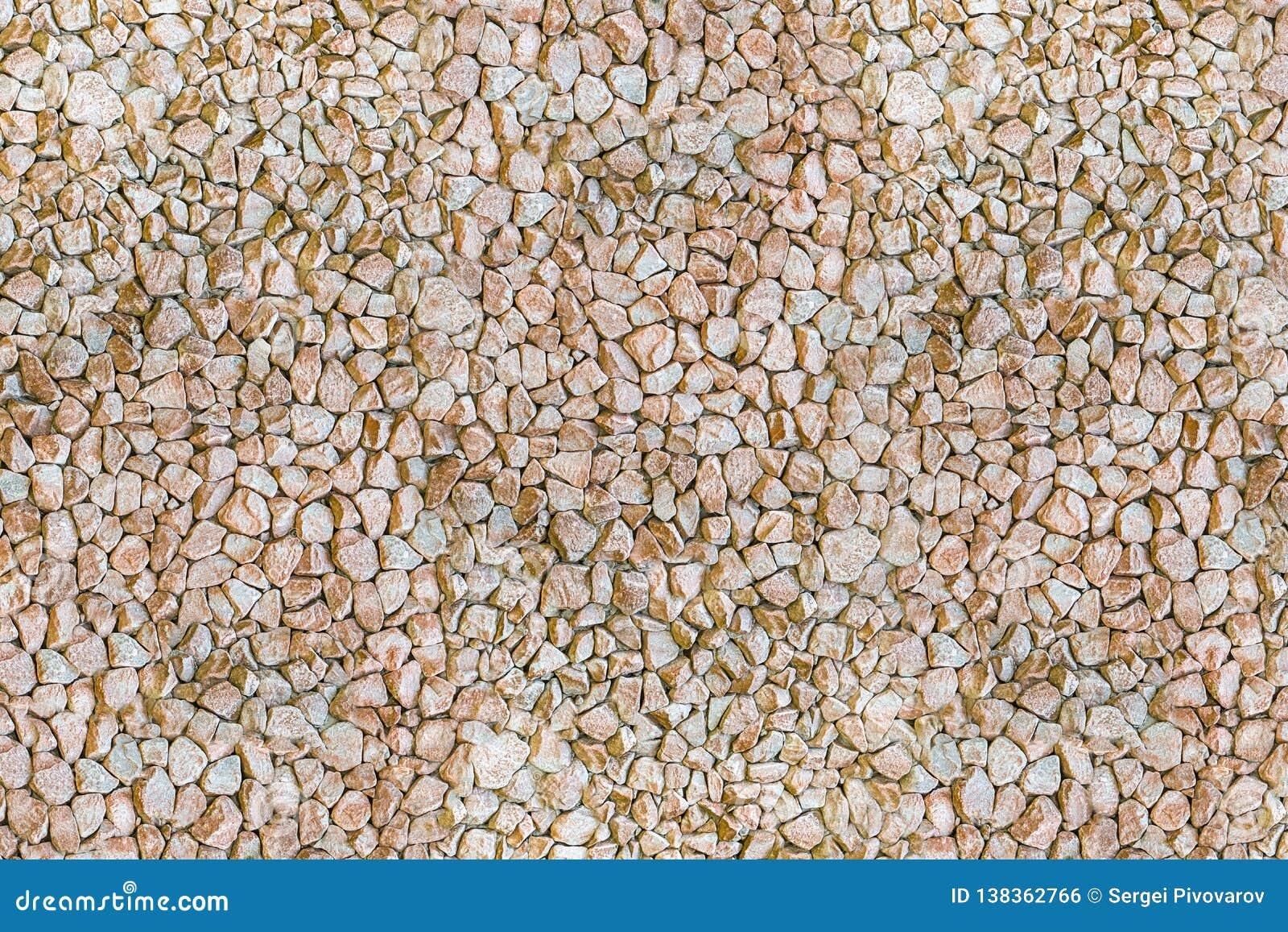 Light beige gray gravel many stones background natural base base design decoration set cobblestone pattern hard