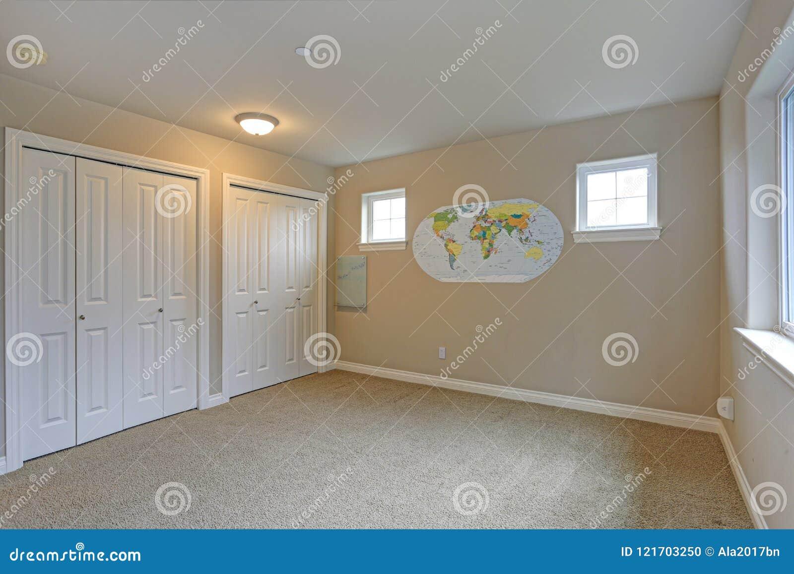 Light beige room interior with white closet doors.