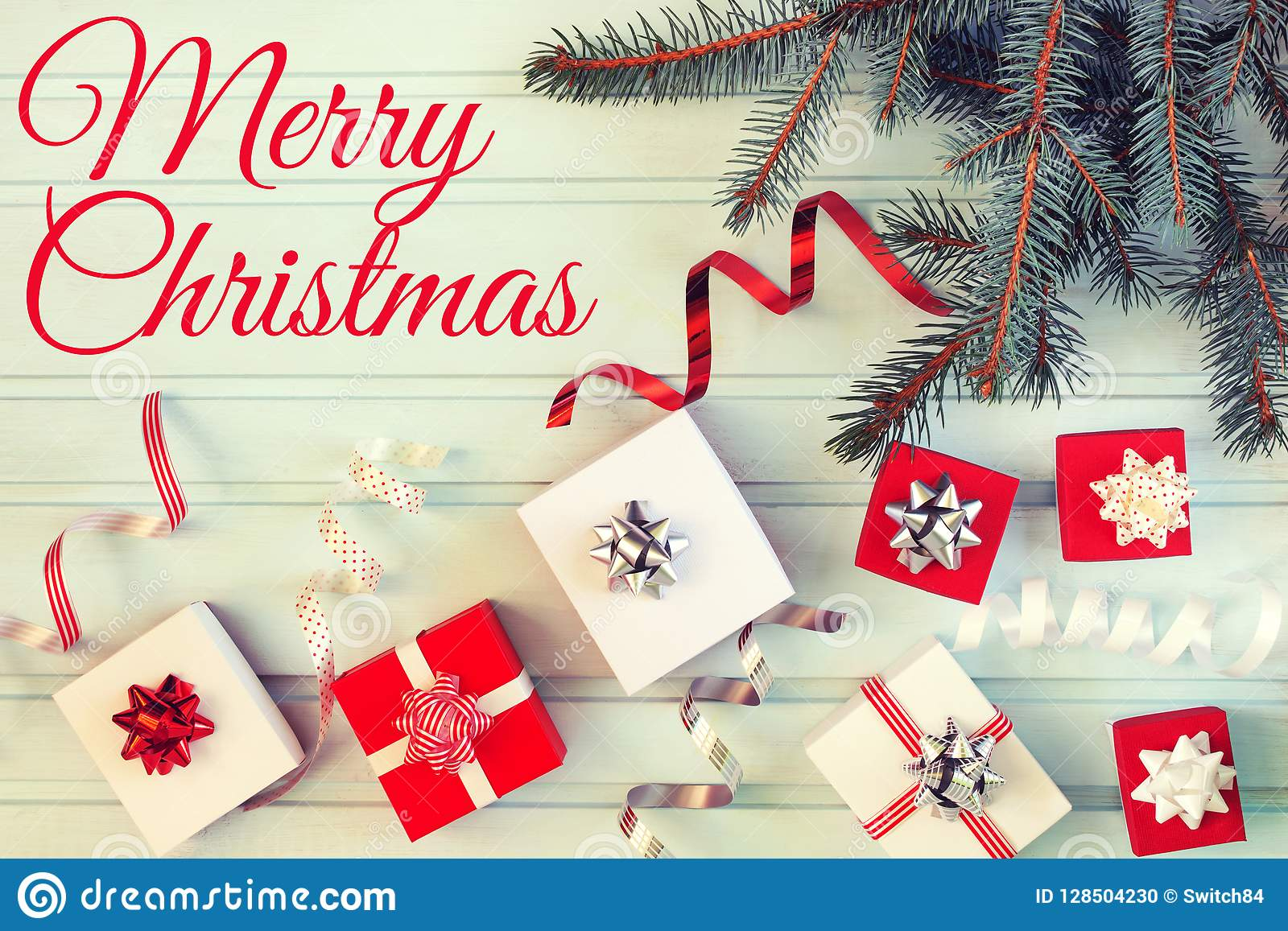 On A Light Blue Background A Christmas Composition Of Small Gift