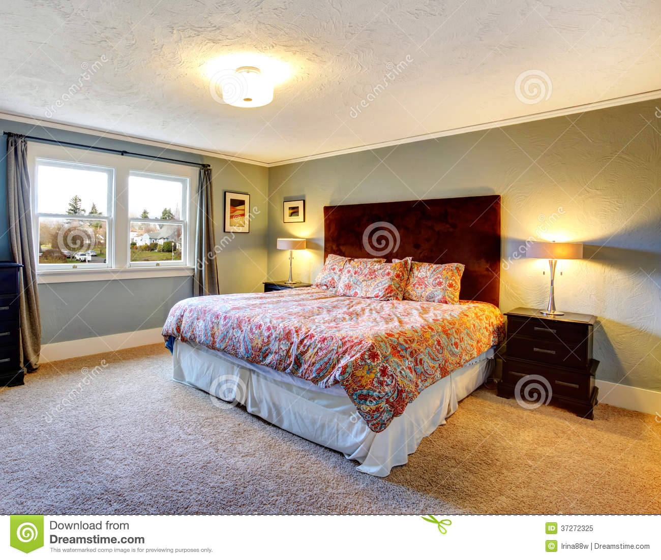 Light Blue Furnished Bedroom With Carpeted Floor Stock