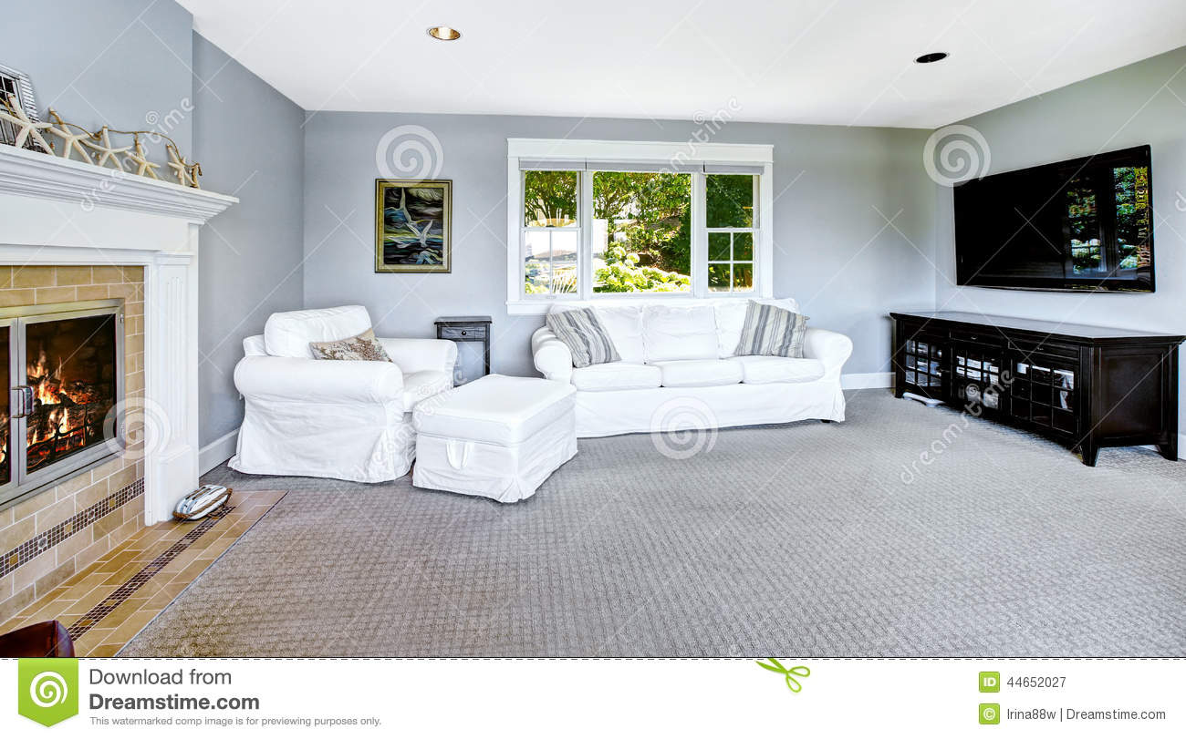 Light Blue Living Room With White Sofa And Fireplace Stock Image ...