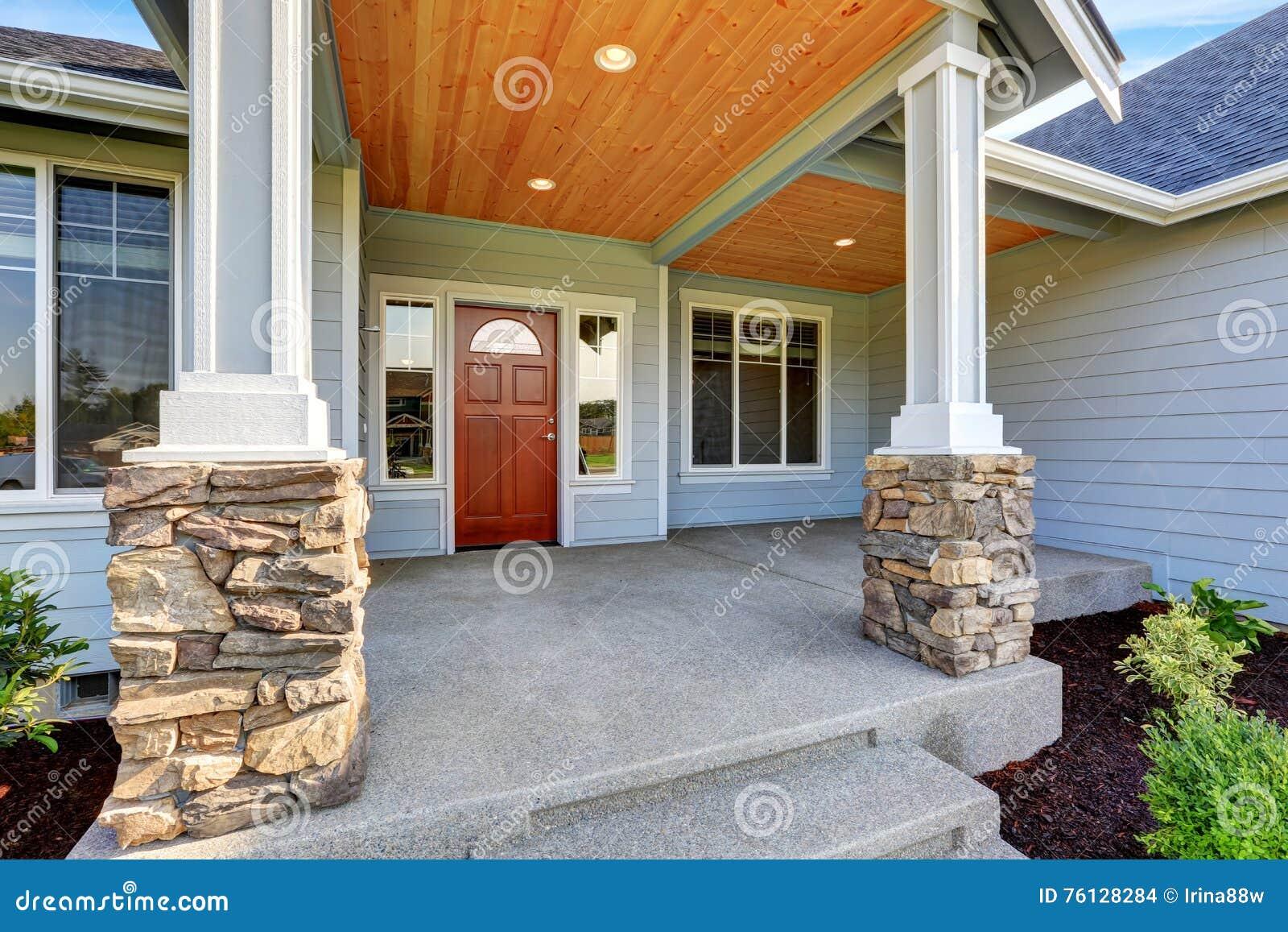 Light Blue Siding House Porch With Stone Base Columns Stock Photo Image Of Stone