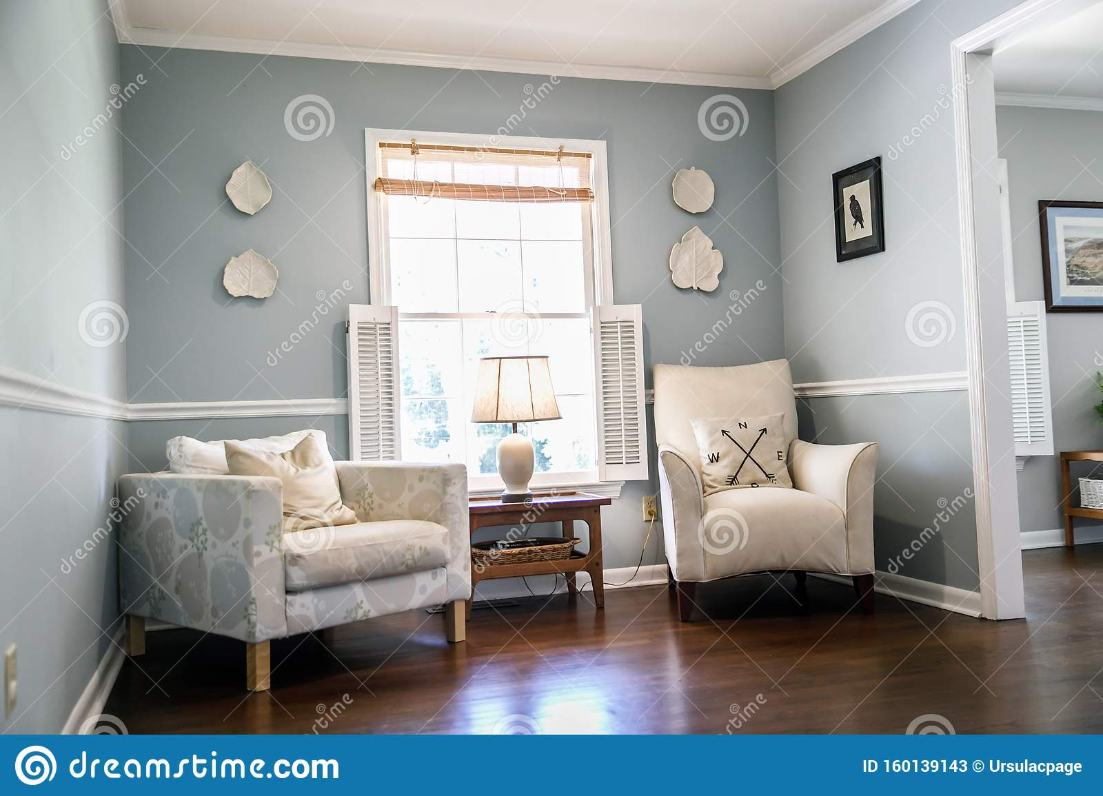 Light Blue Sitting Room With Two Cream Colored Chairs And Decorative Plates On The Wall Stock Image Image Of Decor Entertain 160139143