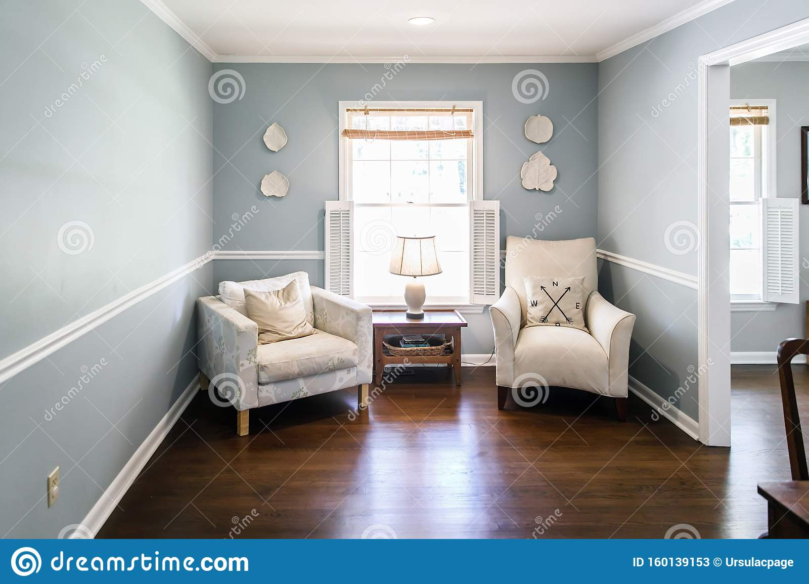 Light Blue Sitting Room With Two Cream Colored Chairs And Decorative Plates On The Wall Stock Image Image Of Apartment Decorative 160139153