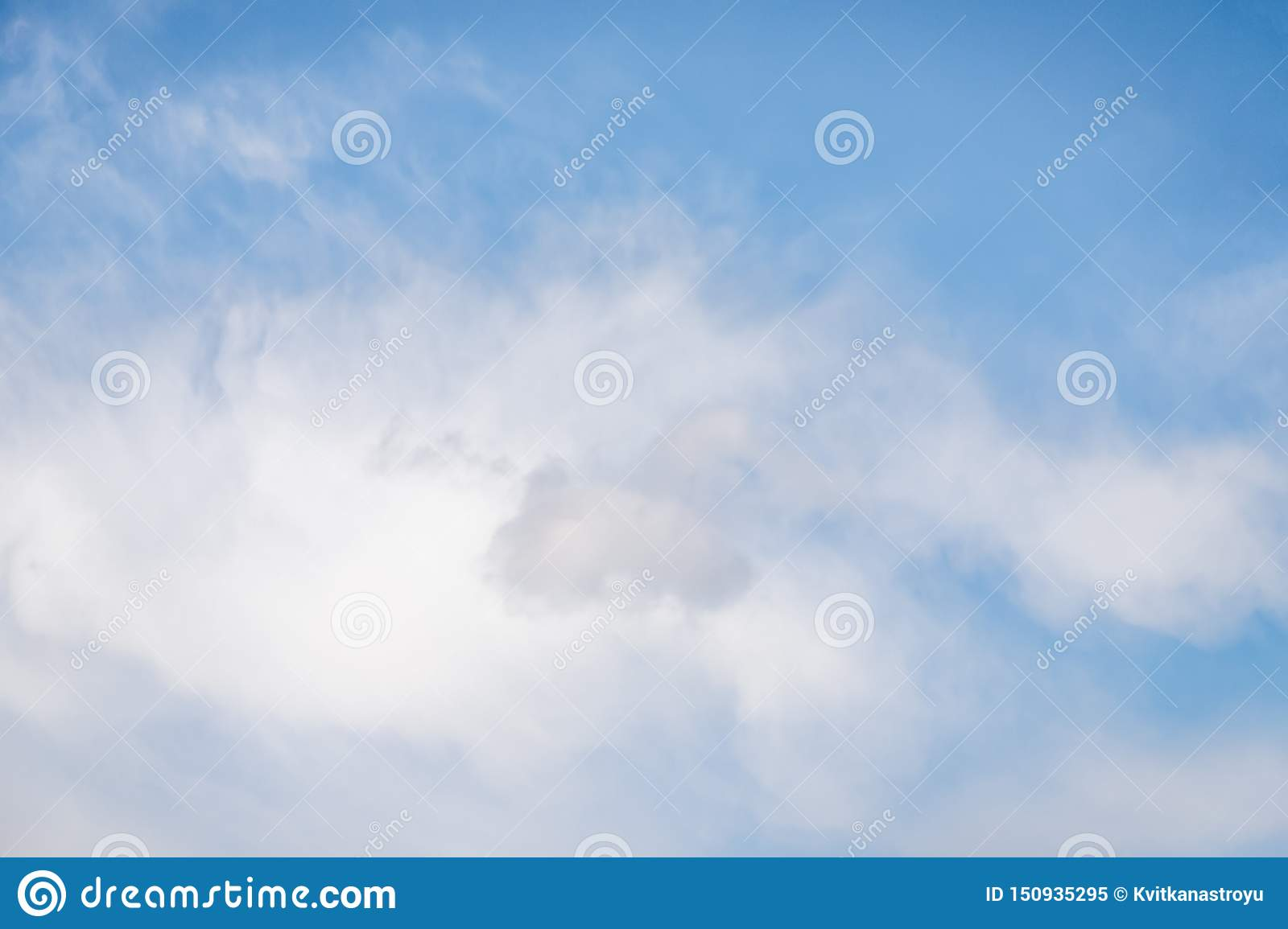 Light blue sky with soft cirrocumulus clouds. Beautiful sky background