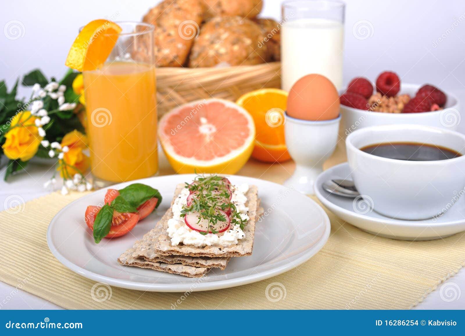 Breaktfast with juice, crispbread, fresh grapefruit, orange, muesly.