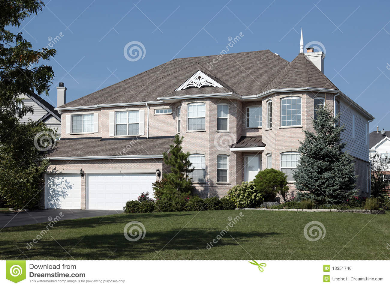 Light brick home with three car garage stock photo image for 3 car garage homes