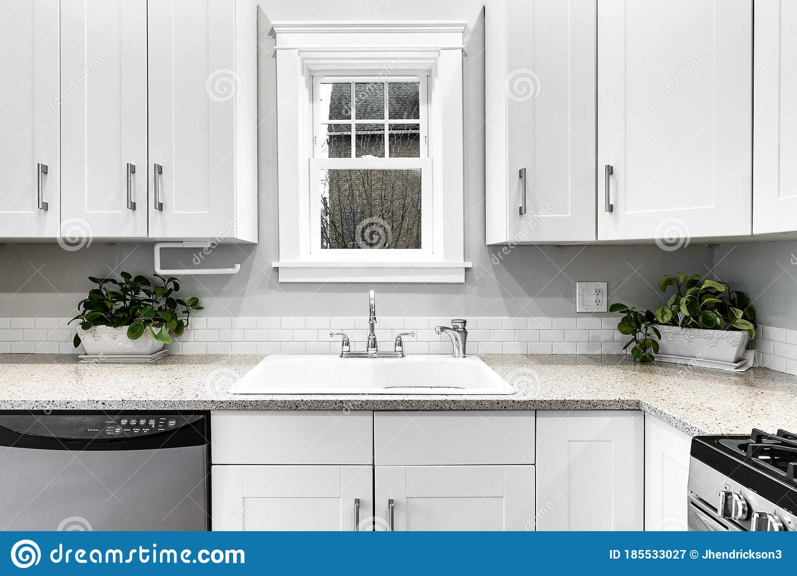 A White Kitchen With Stainless Steel Appliances Stock Image Image Of Design Inside 185533027