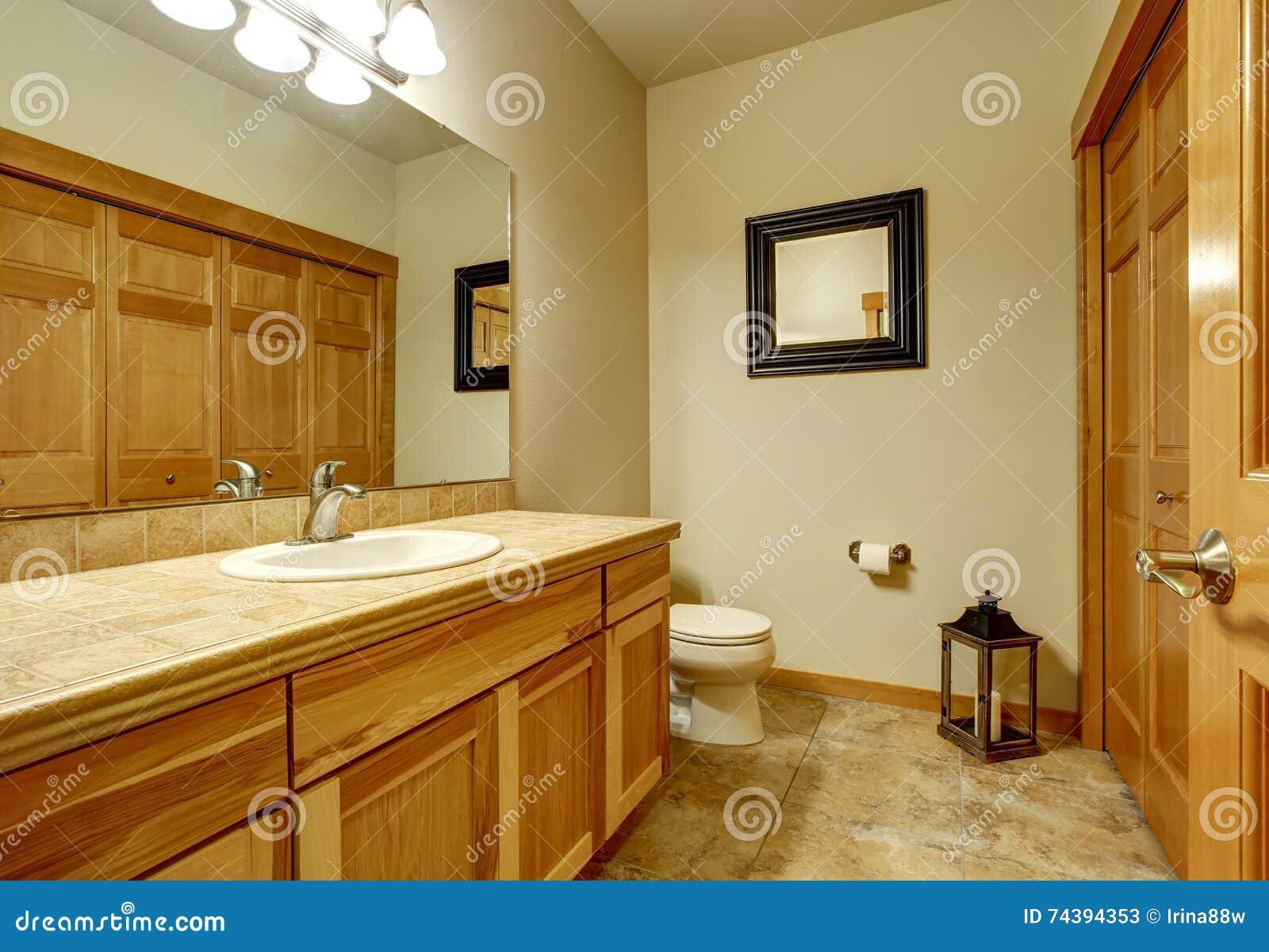 Light Brown Bathroom With Marble Tile Floor And Beige Walls. Stock ...
