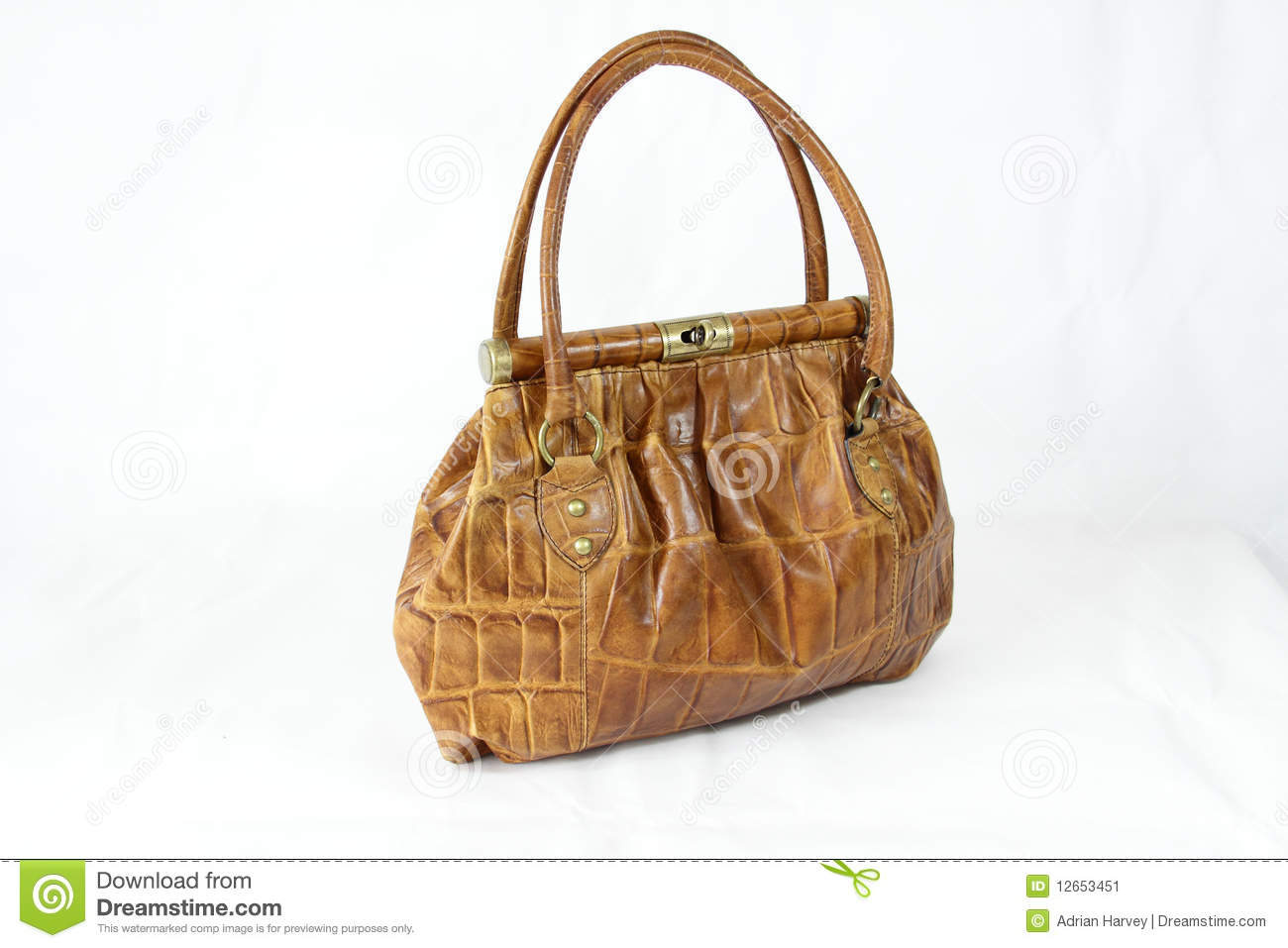 Light brown coloured crocodile skin handbag