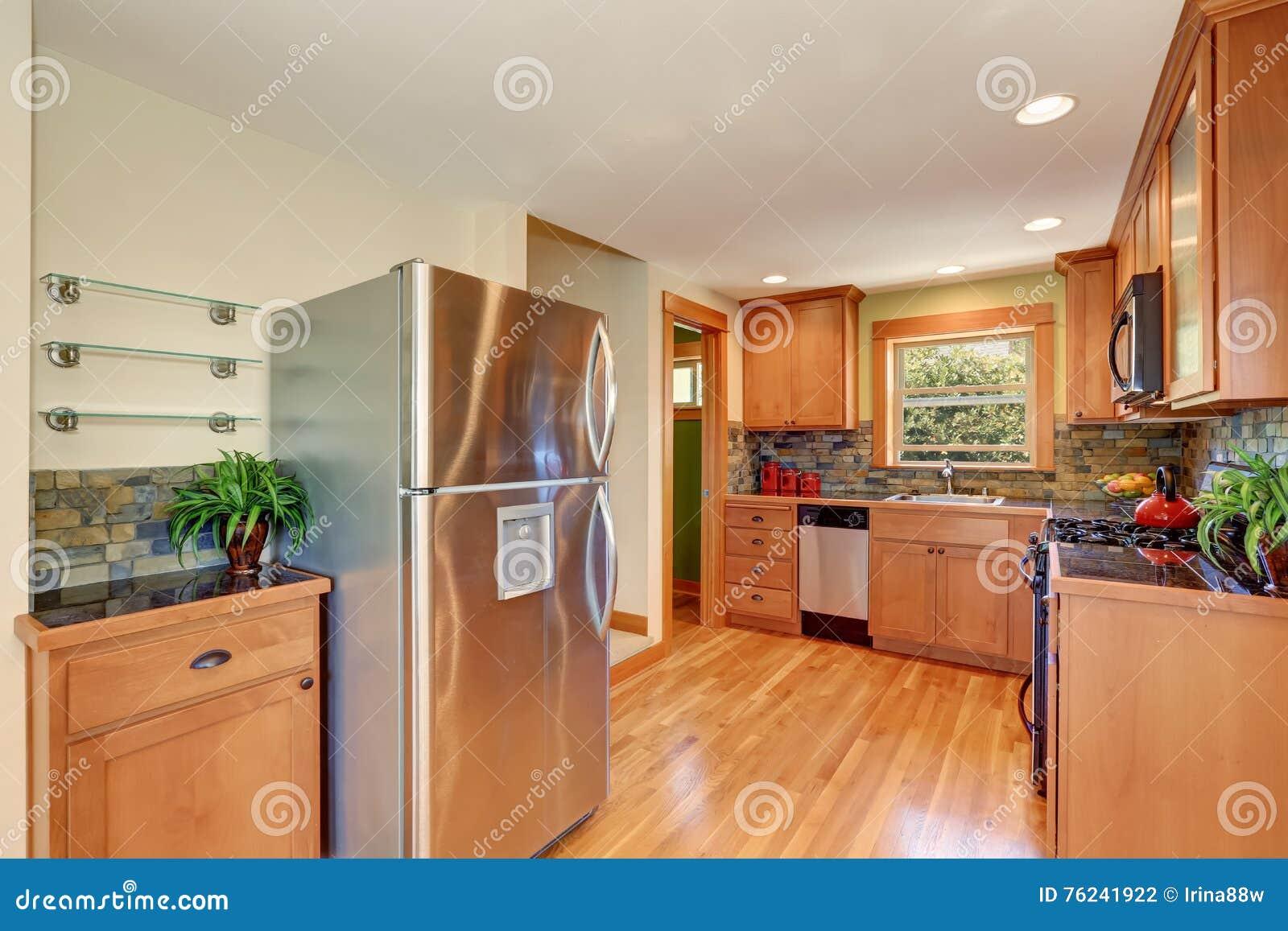 Light Brown Kitchen Cabinetry And Brick Tile Back Splash Trim Stock Photo Image Of Flat Steel 76241922