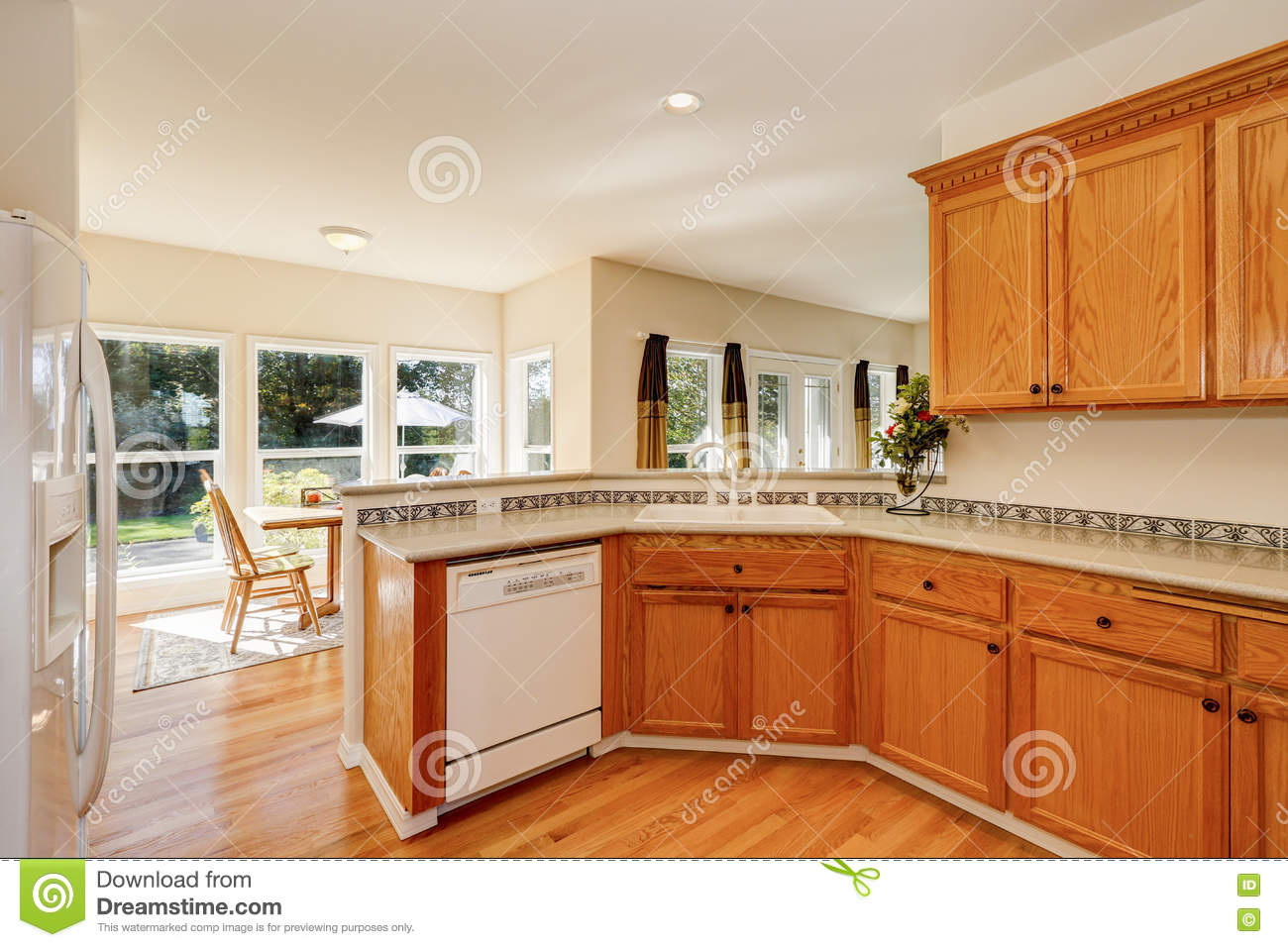 Light Brown Kitchen Cabinets And White Appliances. Northwest, Estate.  Royalty Free Stock Photo. Download Light Brown Kitchen Cabinets ...