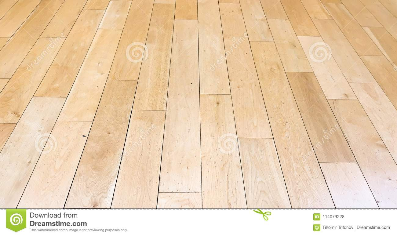 Light brown soft wood floor surface texture as background, varnished wooden parquet. Old grunge washed oak laminate pattern top vi