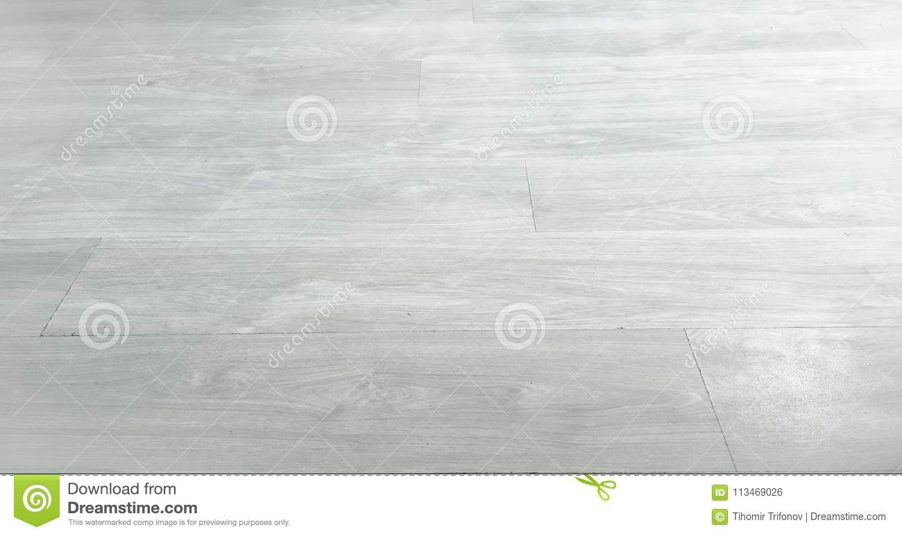 Light brown soft wood floor surface texture as background, wooden parquet. Old grunge washed oak laminate pattern top view.