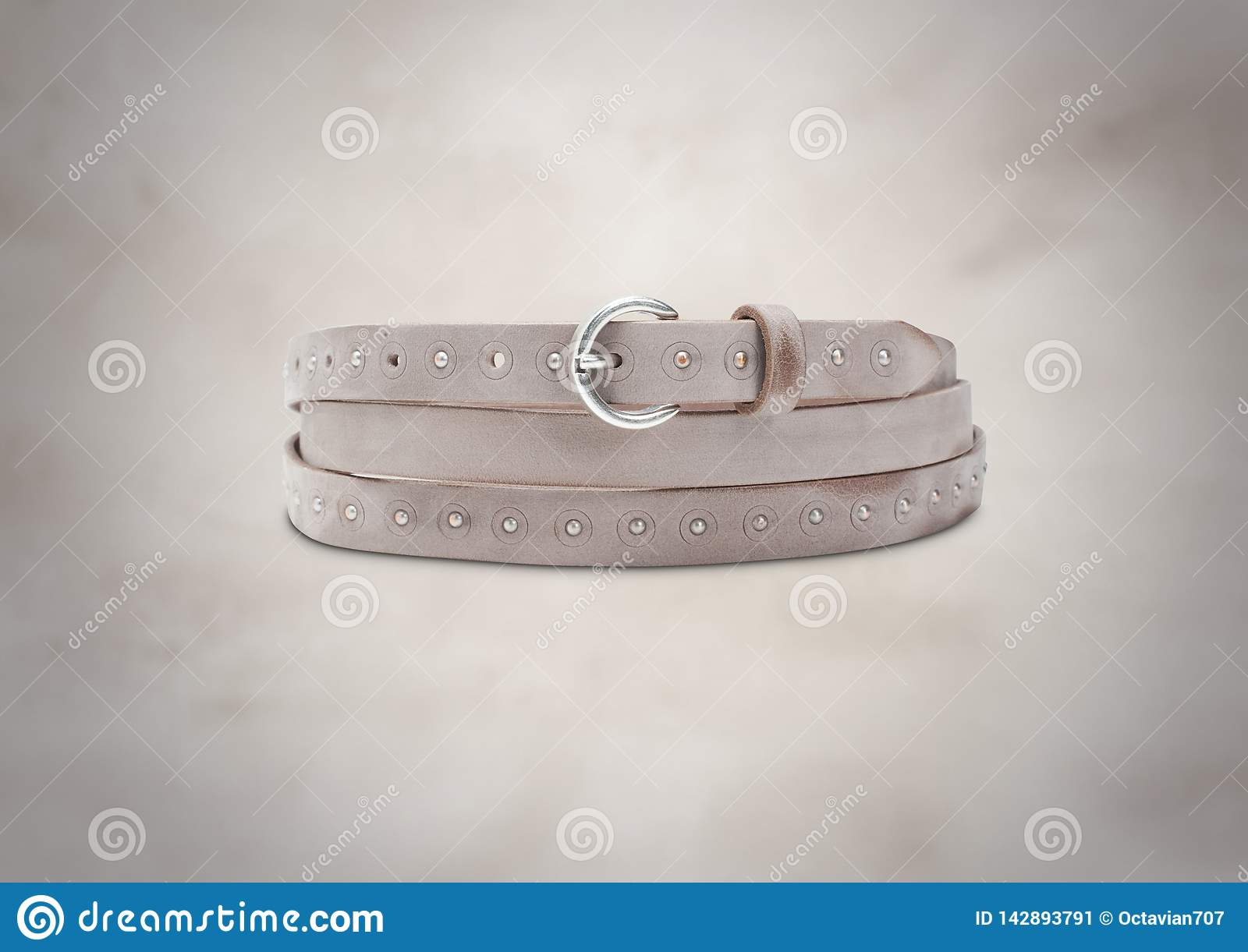 Light brown suede leather belt on beautiful background
