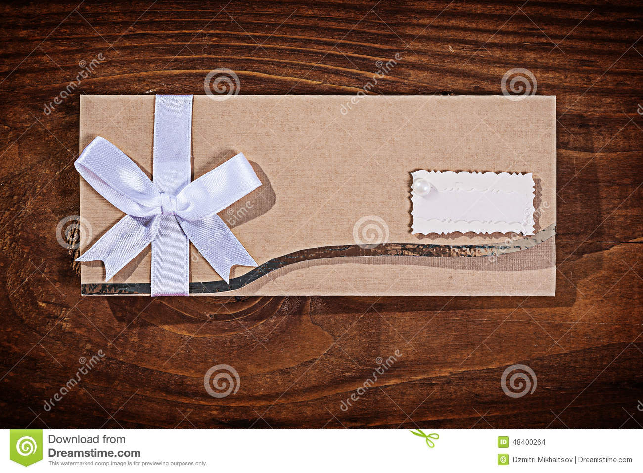 stock photo wedding invitation envelope old wooden board image wedding invitation envelopes Light brown wedding invitation envelope on old wooden board Stock Images