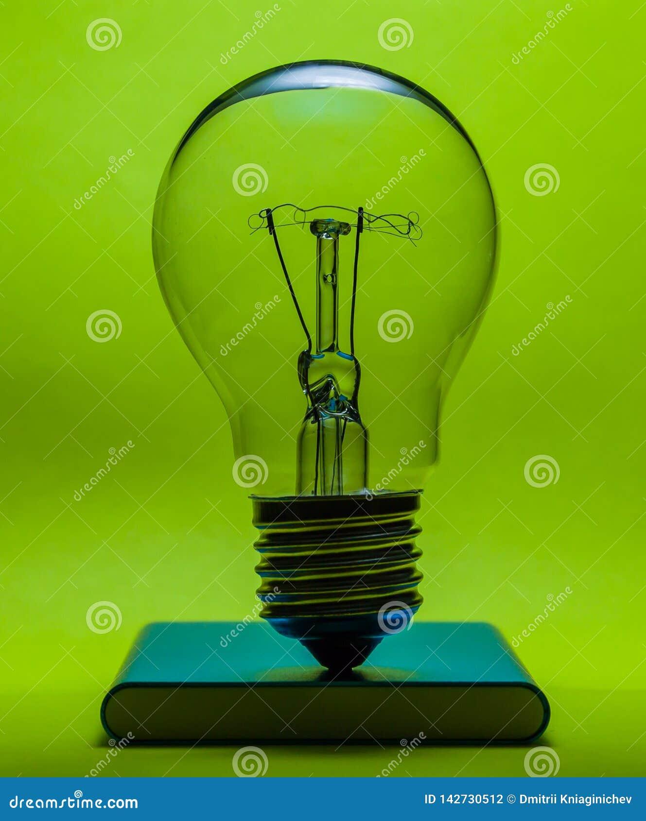Light bulb on green background-image