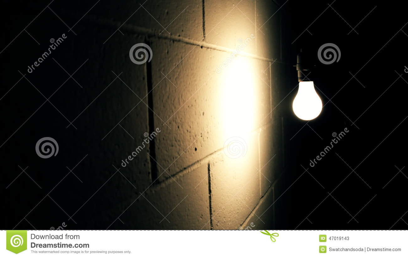 Dark room with light bulb - Light Bulb Swaying Against Wall In Dark Room Stock Video Footage