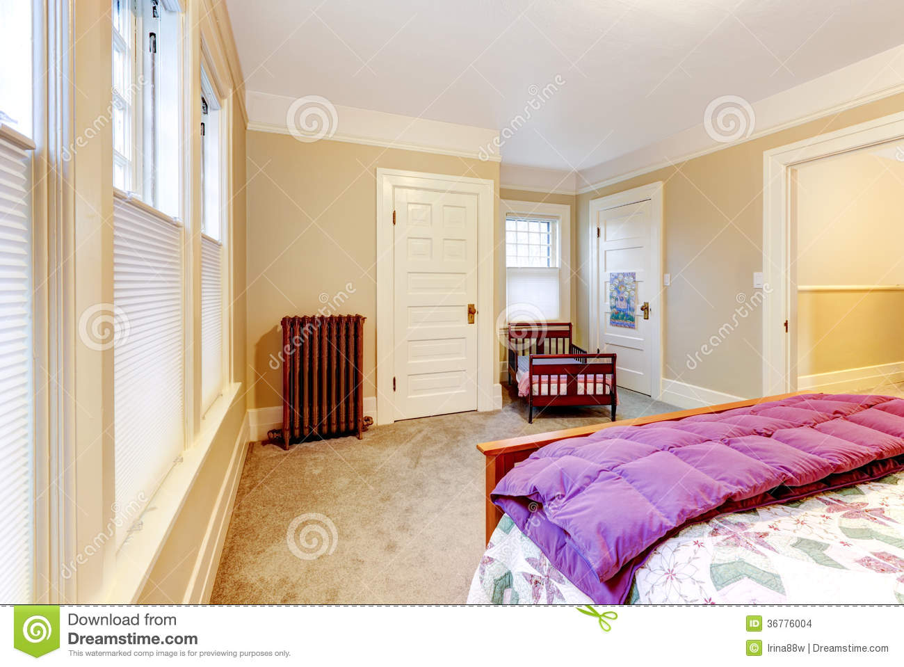 Light Cosy Small Bedroom With Baby Crib Stock Images