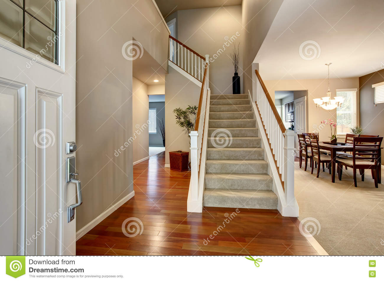 Light Entryway With View Of Staircase Hallway And Dining Room