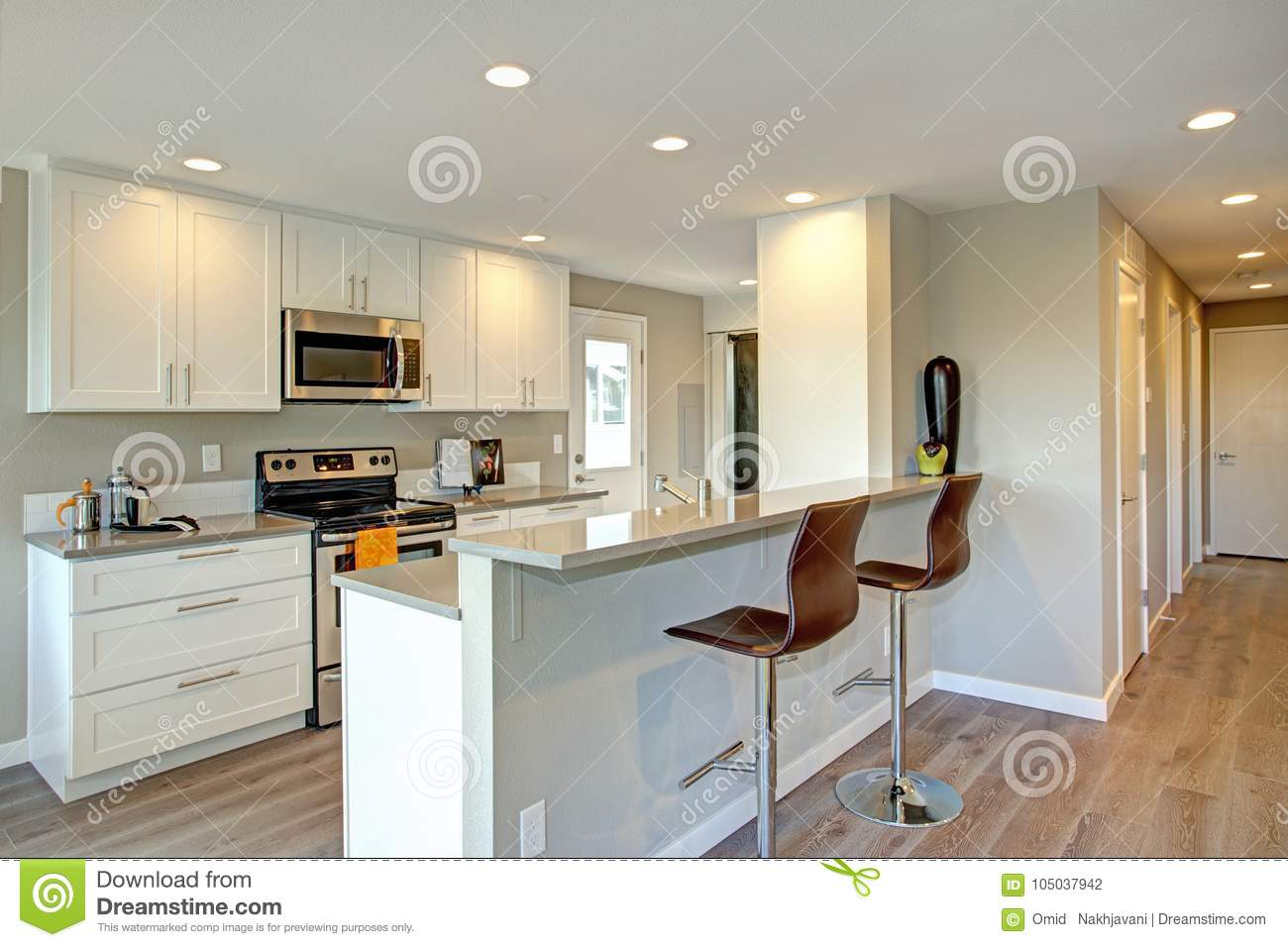 Light filled kitchen with white cabinets stock photo for White stock cabinets